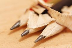 Sharpened pencils on a wooden background closeup Stock Image