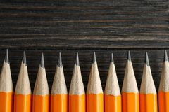 Sharpened pencils on wooden background. Space for text stock images