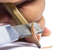 Sharpened wooden pencil by cutter knife  close-up on white backg Stock Image