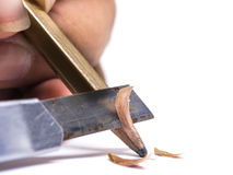 Sharpened wooden pencil by cutter knife  close-up on white backg Stock Photography