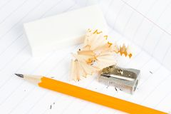 Sharpened wooden pencil, sharpener and eraser Stock Image