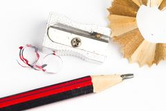 Sharpened wooden pencil, sharpener and eraser Stock Images