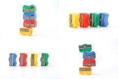 Sharpener για τα χρωματισμένα μολύβια πολυλογάδων Χαρτικά σε μια άσπρη ανασκόπηση στοκ φωτογραφία με δικαίωμα ελεύθερης χρήσης