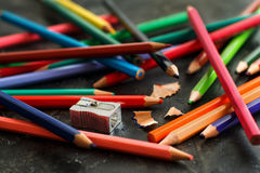 A sharpener and color pensils Royalty Free Stock Images