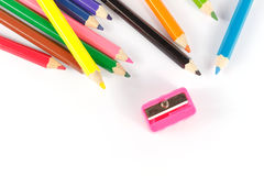 Sharpener with crayon on paper Royalty Free Stock Images