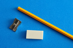 A sharpener, eraser and yellow pencil Stock Photo