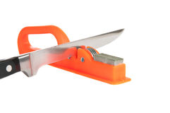 Sharpener and kitchen knife. Over white background Royalty Free Stock Photos