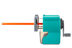 Sharpener and orange pencil. On a white background stock image