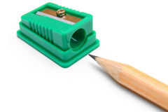 Sharpener and pencil on a white background. Stock Photos
