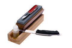 Sharpener stone and knife Stock Images