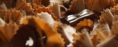 Sharpener and wood shavings - Banner/Header edition. Sharpener and wood shavings  - banner / header editionn Stock Photography