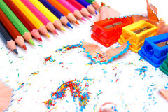Sharpeners and pencils on a white background. Royalty Free Stock Image