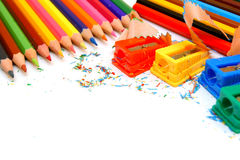 Sharpeners and pencils on a white background. Stock Photos