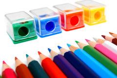 Sharpeners and pencils on a white background. Royalty Free Stock Photography