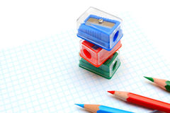 Sharpeners and pencils on a white background. Royalty Free Stock Photo