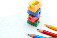 Sharpeners and pencils on a white background. Royalty Free Stock Photos
