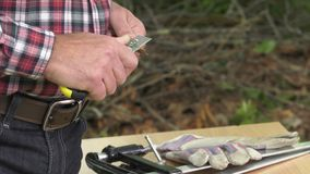 Sharpening of a carpenter's pencil with a blade knife. The pencil will be useful to plot before cutting stock footage