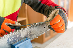 Sharpening a chainsaw Stock Photography