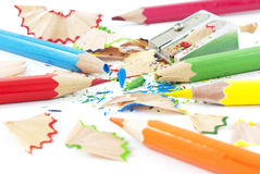 Sharpening of colorful pencils. On white Royalty Free Stock Photos