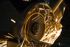 Sharpening and cutting by abrasive disk machine. Sharpening and cutting of iron by abrasive disk machine Stock Images
