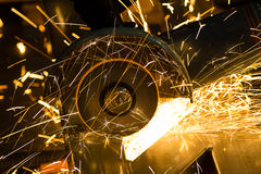 Sharpening and cutting of iron by abrasive disk Stock Photography
