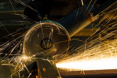 Sharpening and cutting of iron by abrasive disk Stock Photos