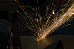 Sharpening and cutting of iron by abrasive disk Stock Image