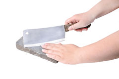 Sharpening or honing a knife on a waterstone, grindstone in woma Royalty Free Stock Photo