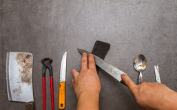 Sharpening the knife. Royalty Free Stock Image
