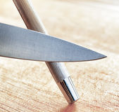 Sharpening of knife in a kitchen Royalty Free Stock Photos