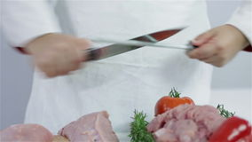 Sharpening knife to cut turkey meat. Professional butcher preparing fresh turkey meat for cooking dishes and freezing in refrigerator for later use. Wide shots stock video