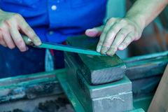 Sharpening Knife With A Whetstone Stock Images