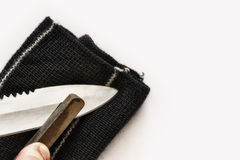 Sharpening a knife in your hand using the grindstone Stock Photography