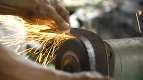Sharpening the machete.