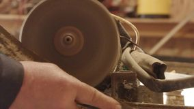 Sharpening an old curve of a rusty spit on a grinding wheel.  stock video footage