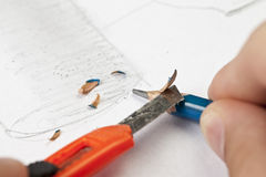 Sharpening a pencil. Stock Images