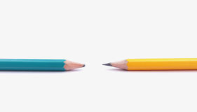 Sharpening pencil and unsharpening pencil. Conception of creative and ignore in the form of sharpening pencil and unsharpening pencil royalty free stock image