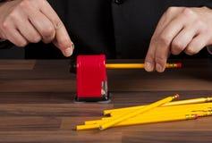Sharpening pencils Stock Photography