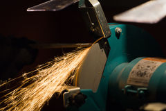 Sharpening process. Sharpening and cutting of iron by abrasive disk machine stock images
