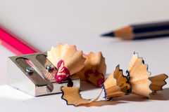 Sharpening a red pencil Royalty Free Stock Photo