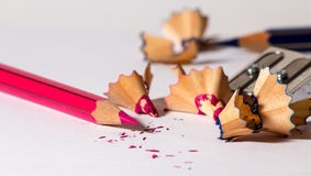 Sharpening a red pencil Stock Image
