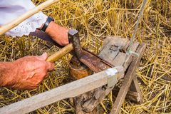 Sharpening a scythe Stock Images