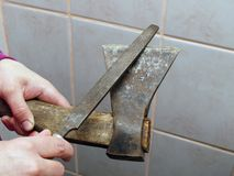 Sharpening an axe Stock Photos