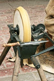 Sharpening wheel and old knife Royalty Free Stock Photo