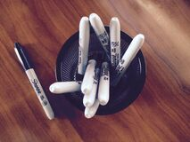 Sharpie pens in holder