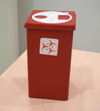 Sharps collector container on the table Stock Photos
