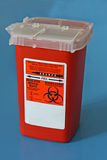 Sharps container for used needles Royalty Free Stock Photo