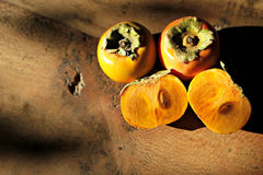 Sharron Fruits. On a wooden table Royalty Free Stock Photos