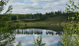 Natural water mirror of the lake Vodop`yanikha royalty free stock photography