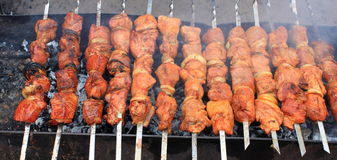 Shashlick laying on the grill closeup Stock Image